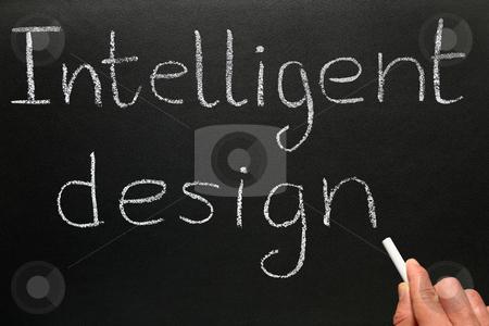 A teacher writing Intelligent Design on a blackboard. stock photo, A teacher writing Intelligent Design on a blackboard. by Stephen Rees