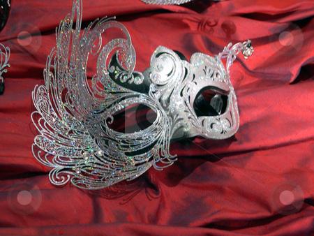 Elegant mask stock photo, An elegant mask atop red velvet by Rob Wright