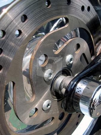 Motorcycle brake rotor stock photo, Close up photo of a motorcycle brake rotor and axle by Rob Wright