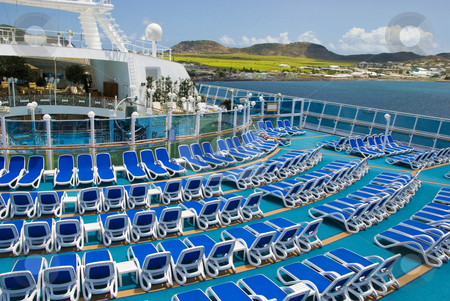 Empty Cruise Ship Deck in the Islands stock photo, A cruise ship deck is empty during a visit to a tropical island by Jeff Clow