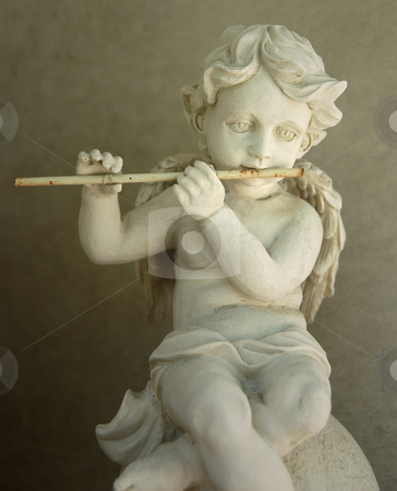 Angel Figure playing a Flute stock photo, Antique figurine, flute plaing angel. by Karen Koomans