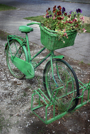 Vintage Bicycle Painted Green stock photo, Painted Old Bicycle with a Basket Full of Flowers by Karen Koomans
