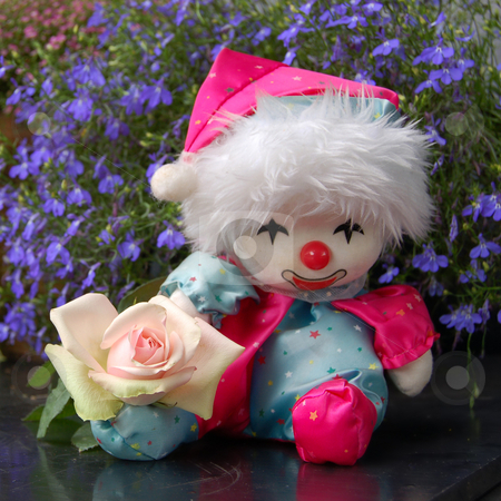 Clown Doll with a Rose stock photo, Cute handcrafted clown doll with a rose. by Karen Koomans