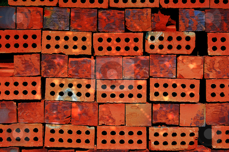 Piled up bricks stock photo, Colorful bricks, piled up at the stone factory. by Karen Koomans