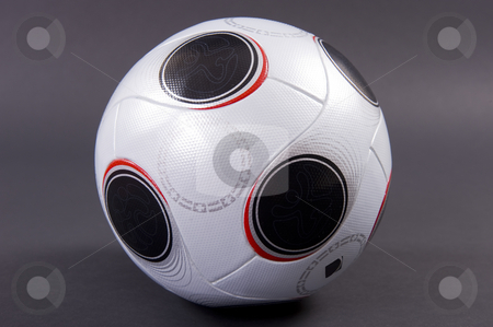 Soccer ball stock photo, An official UEFA EURO2008 match soccer ball in white and black, on dark grey background - not isolated.   soccer, ball, euro2008, UEFA, euro, pass, official, white, design, round, sport, competition, world, championship, club, league, play, compete, europe, sport, football, pattern, team, cup, leather, equipment, goal, champion, match, test, shiny by Nicolaas Traut