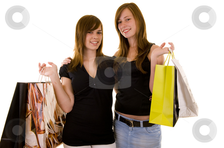 Shopping with the brunettes stock photo, Beautiful young business ladies indicating and shopping, looking happy, isolated on white. by Nicolaas Traut
