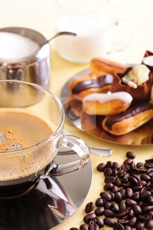 Coffee and Cake stock photo, Freshly brewed coffee with a selection of pastries and cakes. Coffee beans are scattered for extra effect. by Nicolaas Traut