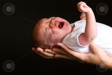 Newborn stock photo, Little 7 days old baby lying securely on mom's arms, against a black background by Mariusz Jurgielewicz