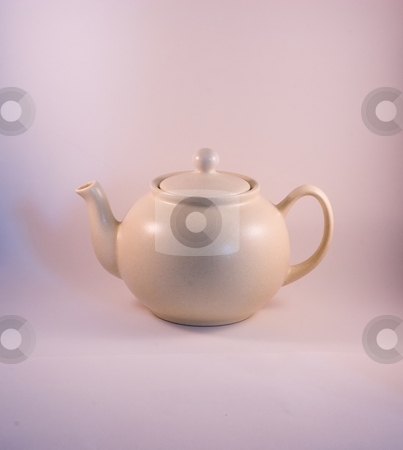 Teapot stock photo, A teapot is a vessel used for steeping tea leaves or an herbal mix in near-boiling water. Tea may be either in a tea bag or loose, in which case a tea strainer will be needed to catch the leaves inside the teapot when the tea is poured. by Mariusz Jurgielewicz