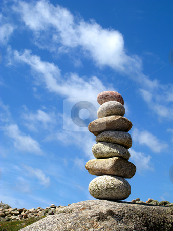A stack of seven balanced stones. stock photo, A stack of seven balanced stones. by Stephen Rees