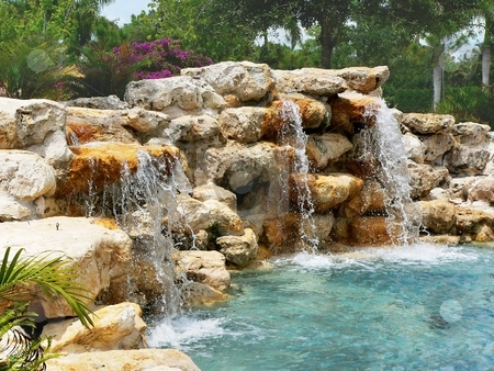 Waterfall stock photo, Stone wall with waterfall and blue pool of water by Perry Correll