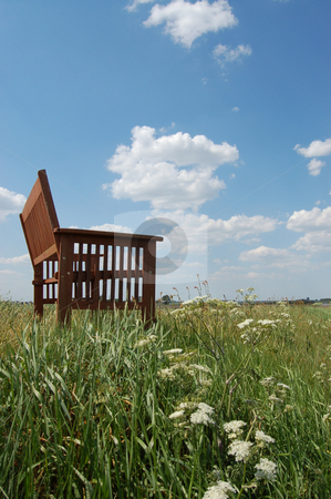 Take a seat, enjoy the view stock photo, Picture from a series of landscape photos, in which this bench invites you to take a seat and enjoy the view. The landscapes in this series are in Groningen en Drenthe, The Netherlands, Europe. by Karen Koomans