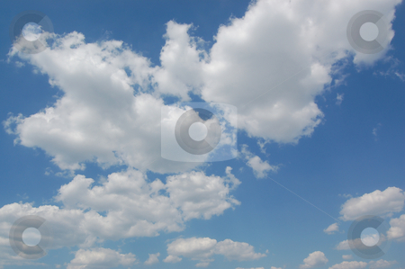 Blue sky with cumulus clouds stock photo, Blue sky with cumulus clouds. by Karen Koomans