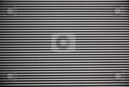 Close-up of a metal rolldown shutter stock photo, Close-up of a metal roll down shutter. Use as a background or to add texture to your design. by Karen Koomans