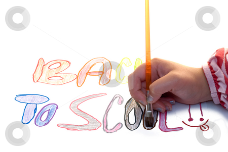 Painting Back To School stock photo, A young child's hand holding a paint brush, trying to paint in the letters of her artwork by Richard Nelson