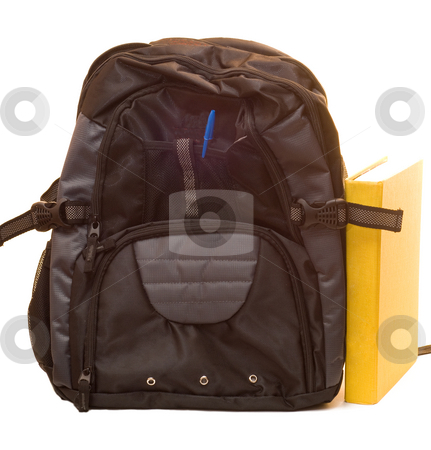 School Supplies stock photo, A backpack and a textbook, isolated on a white background by Richard Nelson