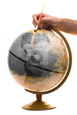 Brightening Up The Planet stock photo, A model of the earth being painted as a symbolic way of showing someone brightening up the planet by Richard Nelson