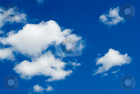 Fluffy Clouds stock photo, A background of white fluffy clouds shot on a deep blue sky by Richard Nelson