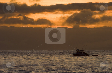 The 3 Hour Tour stock photo, A small charter boat cruising off Maui as the sun sets, the title on the Gilligans Island theme by Mike Dawson