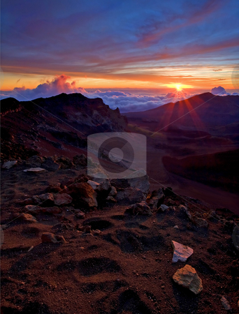 Alien Sunrise stock photo, The Alien landscape inside the creater of Haleakala on Maui, Hawaii as the sun rises over the horizon. by Mike Dawson