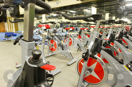 Gym equipment stock photo, Gym or gymnasium equipment in a world-class facility suitable for athletes training for international events. Picture shows fitness cycles. by Nicolaas Traut