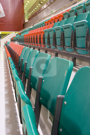 Spectator chairs stock photo, Rows of folded spectator chairs at an International sport venue in Doha, Qatar. Shallow DOF. by Nicolaas Traut