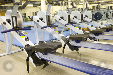 Gym equipment stock photo, Gym or gymnasium equipment in a world-class facility suitable for athletes training for international events. Picture shows rowing machines. by Nicolaas Traut