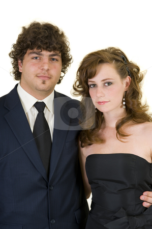 Portrait of young couple stock photo, Portrait of an attractive young couple, dressed up in formal wear and ready to go to the prom. by Nicolaas Traut