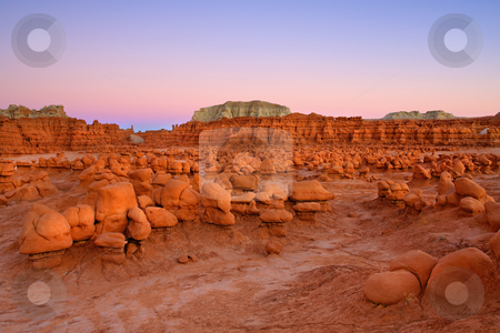 Goblin Glow stock photo, Last Light illuminating the odd formations of Goblin Valley State PArk in Utah. by Mike Dawson