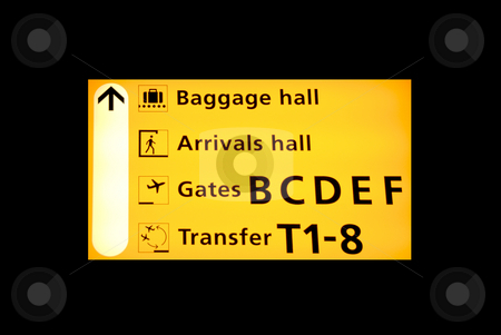 Airport sign stock photo, Airport sign to the baggagehall, arrivals or transfer on Schiphol Airport by Claudia Van Dijk