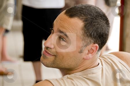 Man looking over his shoulder stock photo, Man looking over his shoulder. Shallow Dof by Claudia Van Dijk