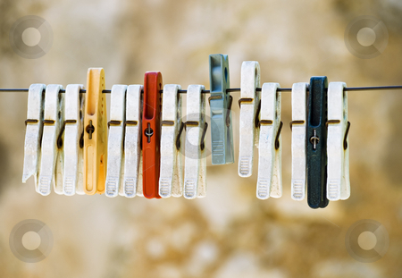 Clothes line pegs stock photo,  by Sinisa Botas