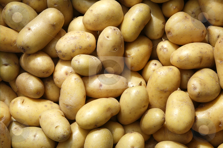 Close up of new potatoes outside a greengrocers. stock photo, Close up of new potatoes outside a greengrocers. by Stephen Rees