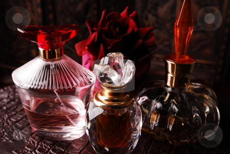 Perfume bottles1 stock photo, Selection of perfume bottles in romantic setting. by Nicolaas Traut