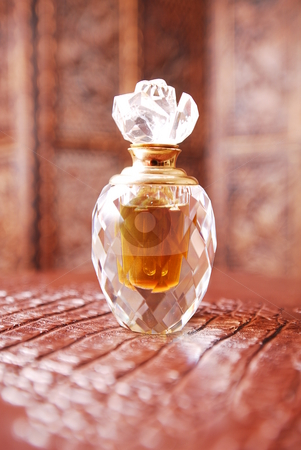 Crystal perfume bottle1 stock photo, Crystal perfume bottle in romantic setting. by Nicolaas Traut