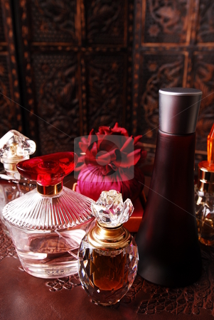 Perfume bottles3 stock photo, Selection of perfume bottles in romantic setting. Copy space on top. by Nicolaas Traut