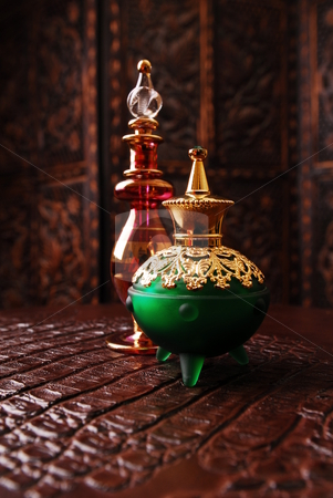 Perfume bottles stock photo, Egyptian perfume bottles in warm romantic setting. by Nicolaas Traut