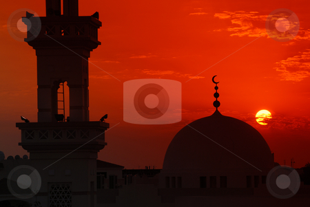 Mosque sunset stock photo, Mosque silhouette etched against a dramatic sunset by Nicolaas Traut