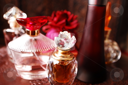 Perfume bottles2 stock photo, Selection of perfume bottles in romantic setting. by Nicolaas Traut