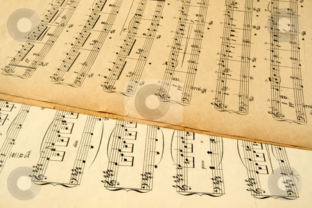 Old yellowing music sheets from the early 20th century. stock photo, Old yellowing music sheets from the early 20th century. by Stephen Rees