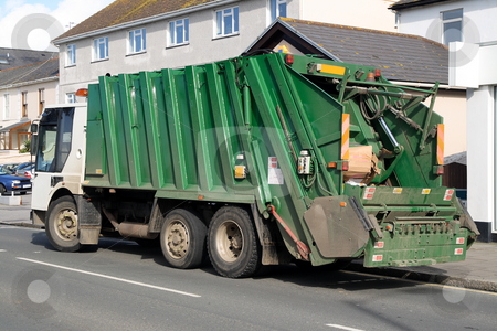 Green rubbish truck with boxes in the back. stock photo, Green rubbish truck with boxes in the back. by Stephen Rees