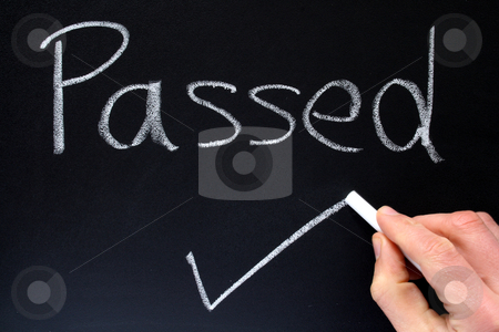 A teacher writing passed on a blackboard. stock photo, A teacher writing passed on a blackboard. by Stephen Rees