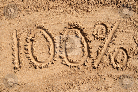 100 percent written on a sandy beach stock photo, 100% written on a sandy beach. by Stephen Rees