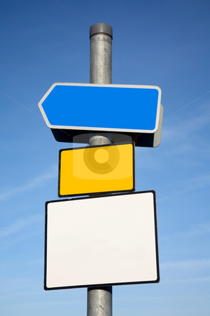 Signpost with 3 blank signs. stock photo, Signpost with 3 blank signs. by Stephen Rees