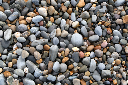 Close up of colorful stones on a beach. stock photo, Close up of colorful stones on a beach. by Stephen Rees