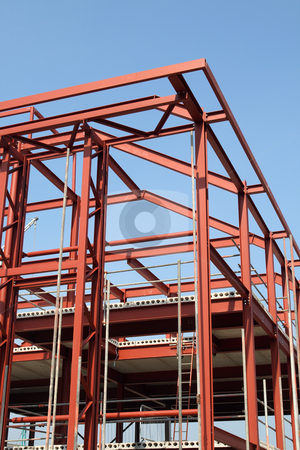 Vertical view of a red steel building construction framework. stock photo, Vertical view of a red steel building construction framework. by Stephen Rees