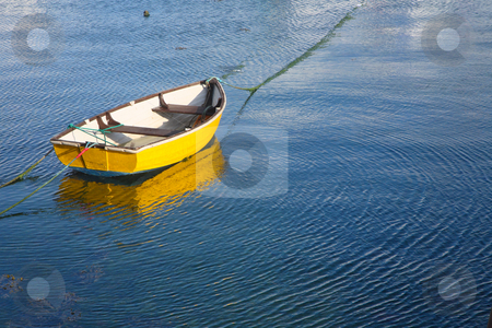 A yellow boat and water ripples. stock photo, A yellow boat and water ripples. by Stephen Rees