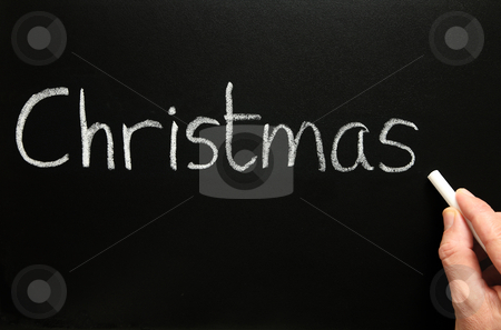 Writing Christmas on a blackboard. stock photo, Writing Christmas on a blackboard. by Stephen Rees
