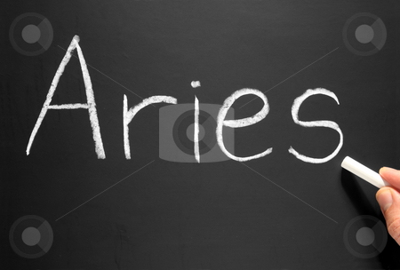 The star sign Aries written on a blackboard. stock photo, The star sign Aries written on a blackboard. by Stephen Rees
