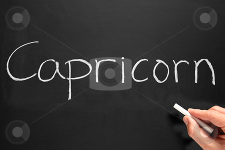 The star sign Capricorn written on a blackboard. stock photo, The star sign Capricorn written on a blackboard. by Stephen Rees